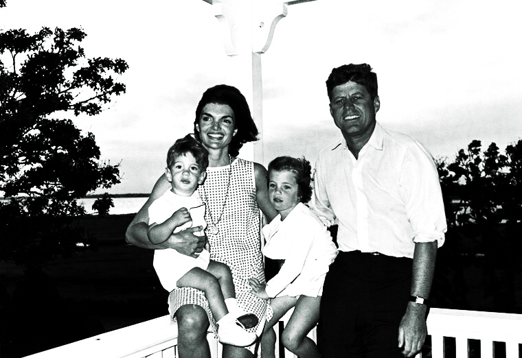 04 August 1962 President Kennedy and family, Hyannis Port. L-R: John F. Kennedy Jr., Mrs. Kennedy, Caroline Bouvier Kennedy, President Kennedy. Photograph by Cecil Stoughton, White House, in the John F. Kennedy Presidential Library and Museum, Boston.